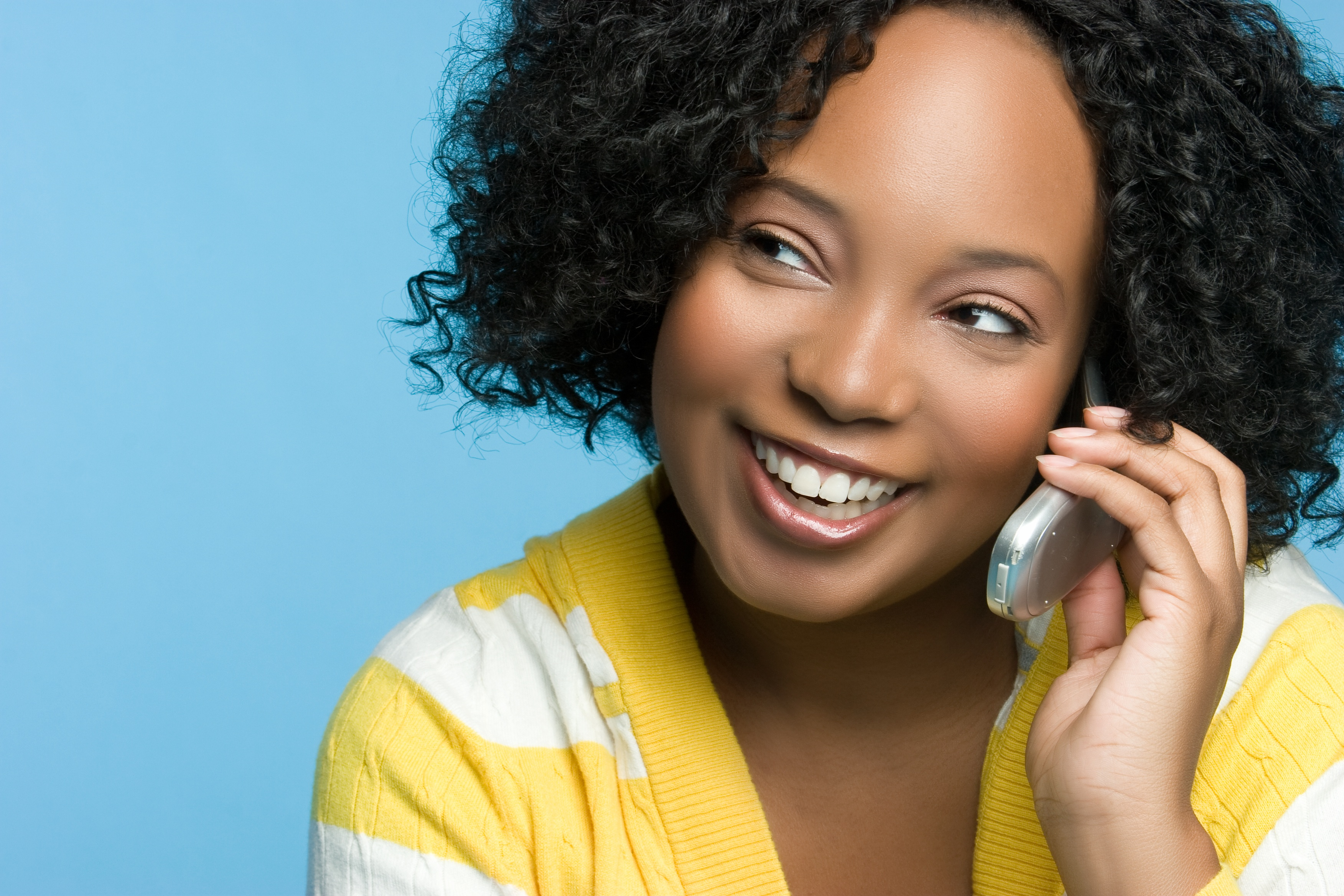 Woman talking on phone 340B home delivery pharmacy